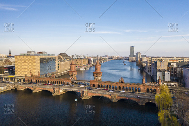 March 17, 2020: View from above of Oberbaum bridge, Spree River and Treptower park in the background, Berlin, Germany, Europe