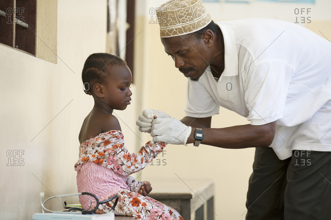 Doctor treating a young girl at a medical clinic in Africa
