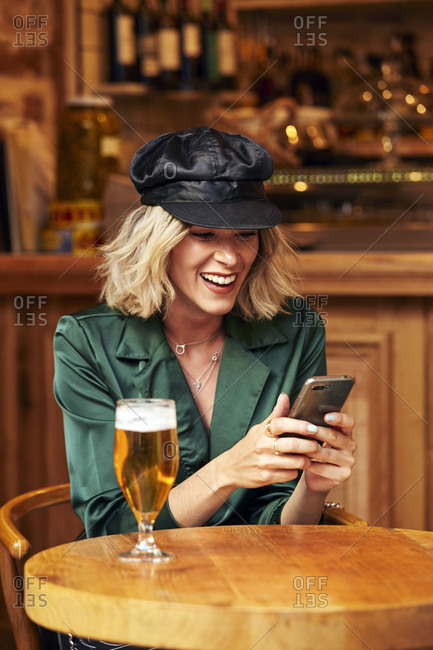 Blonde woman in her 30s looking at her mobile phone