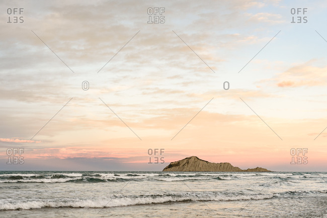 View of Te Motu-o-Kura island in New Zealand at sunset