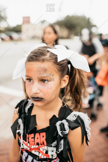 Girl dressed as a zombie cheerleader for Halloween