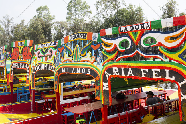 Mexico City, Mexico - November 2, 2017: Detail view of colorful tour boats in the Xochimilco area