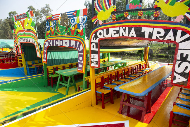 Mexico City, Mexico - November 2, 2017: Colorful painted tour boats in the Xochimilco area