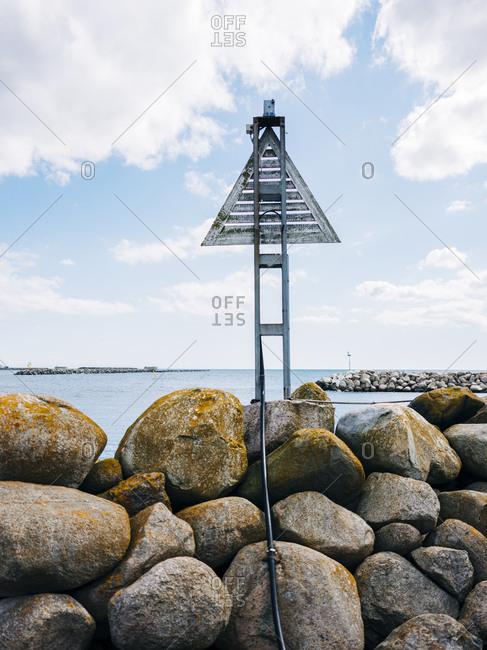 Sign on rocky harbor in Sweden