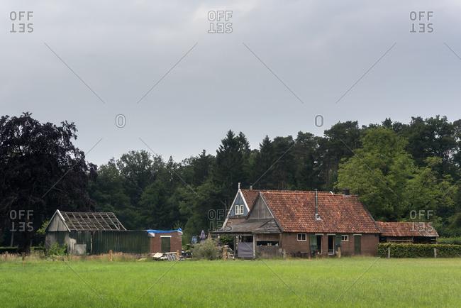Old farmhouse under cloudy sky