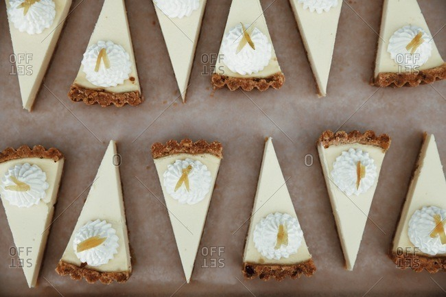 Slices of cheesecake neatly arranged in rows