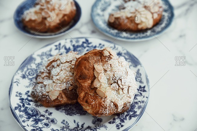 Close up of almond pastries on fancy plates