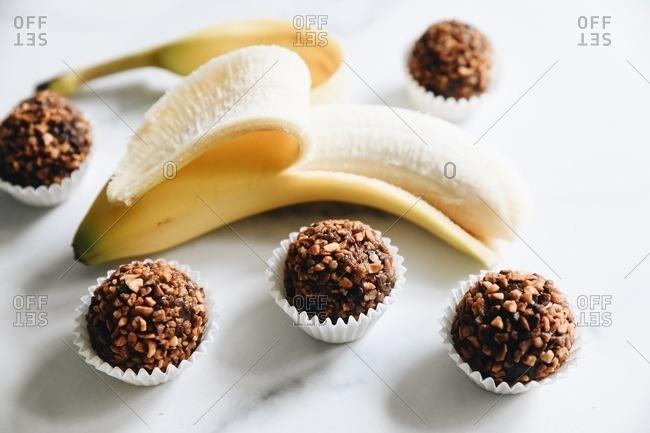 Bananas and nut chocolate brigadeiro on marble surface