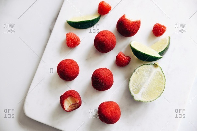 Overhead view of raspberry lime white chocolate brigadeiro truffles