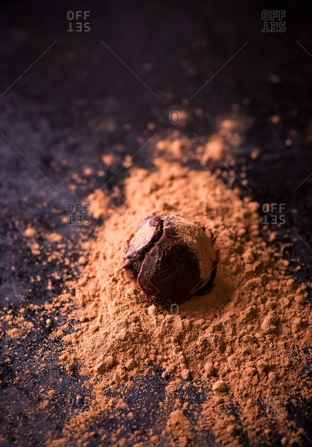 Dark chocolate truffles with cocoa powder over baking paper