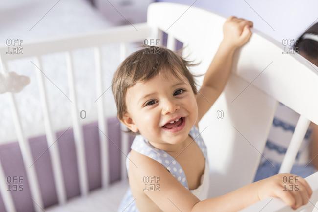 Adorable toddler in bedroom crib