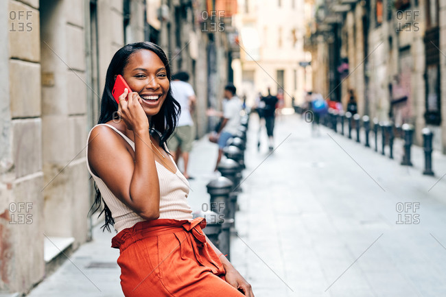 Young black woman on the streets using a smart phone
