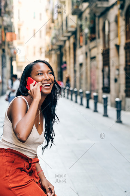Young black woman on the streets using a cell phone