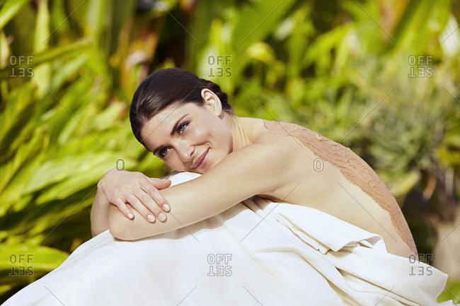 Caucasian woman having mud spa treatment
