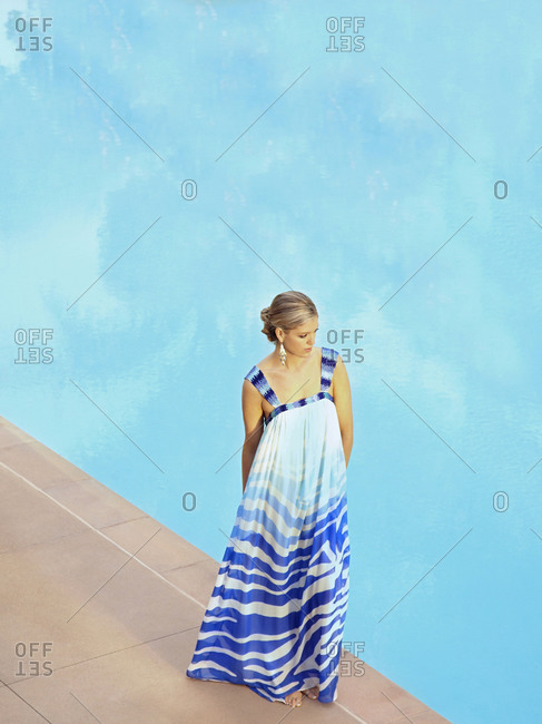 Caucasian woman standing at poolside