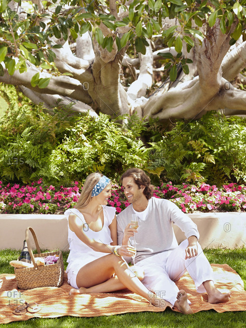 Caucasian couple having a picnic outdoors