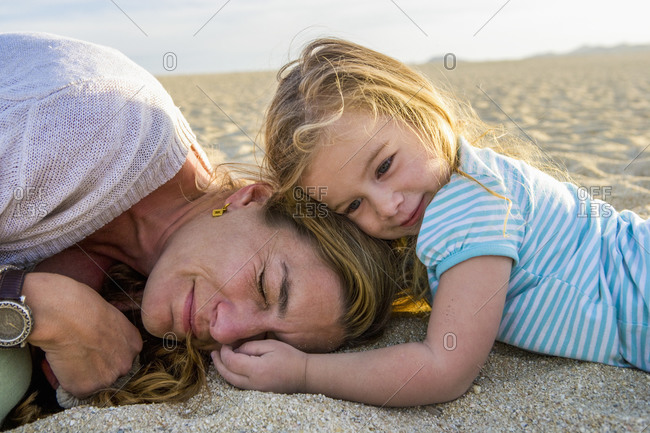 Mother and daughter playing on beach, Cabo San Lucas, Mexico