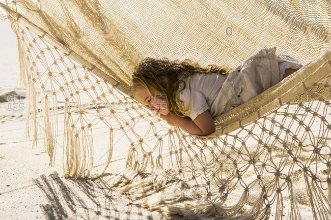3 year old girl resting in hammock, Cabo San Lucas, Mexico