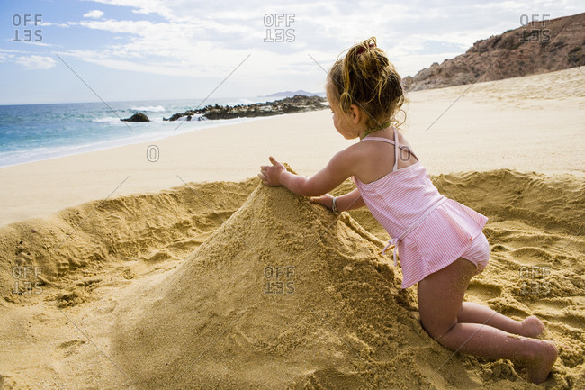 Young girl playing in sand, Cabo San Lucas, Mexico