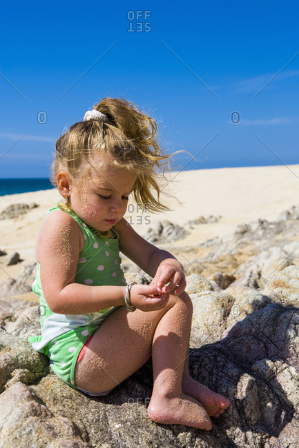 3 year old girl playing on beach, Cabo San Lucas, Mexico