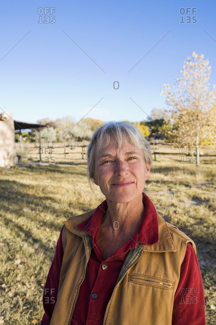 Mature woman at home on her property in a rural setting