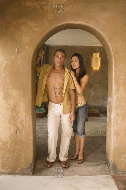 Portrait of couple standing in doorway