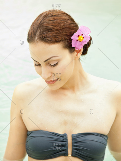 Smiling mixed race woman in bikini