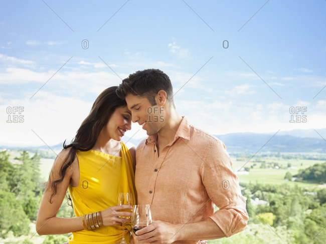 Couple drinking cocktails and hugging