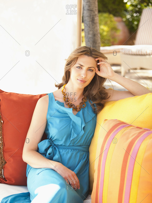 Beautiful well dressed woman in outdoor lounge at luxury resort in Napa Valley California