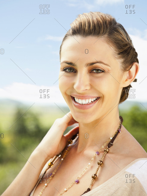 Close up portrait of beautiful woman smiling at camera