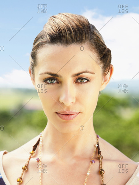 Close up portrait of beautiful woman with serious expression