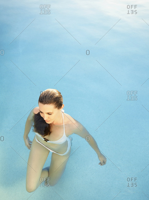 Overhead view of woman with wet hair in water at a luxury resort in California