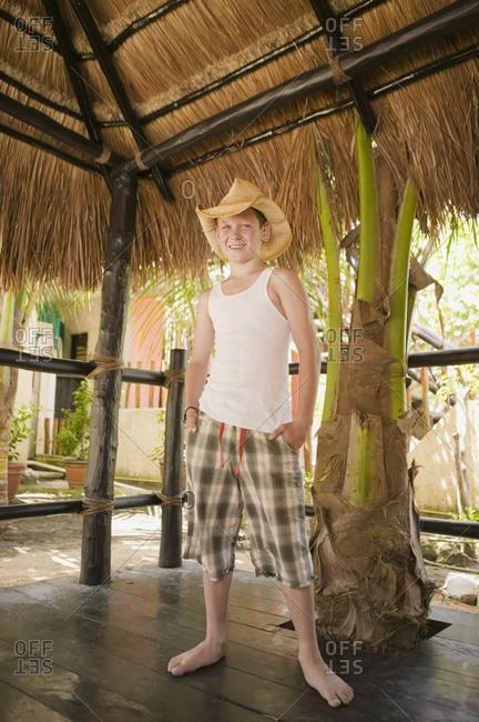 Young boy wearing a cowboy hat