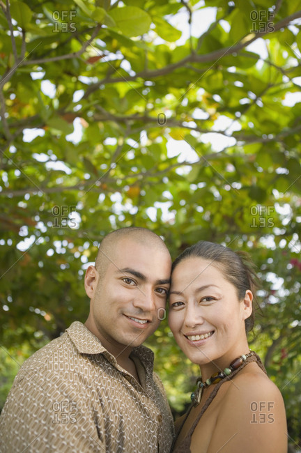 Couple posing for the camera outdoors