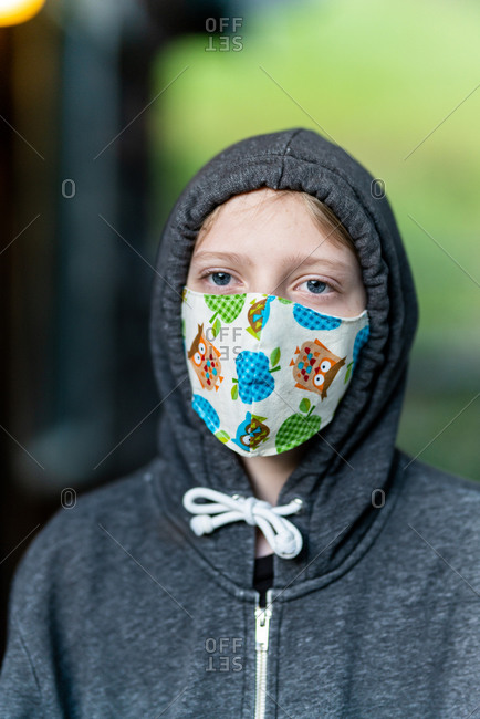 Tween wearing homemade face mask during COVID-19 Pandemic with hoodie