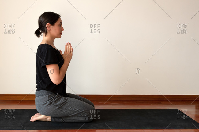 Woman doing yoga poses at home.