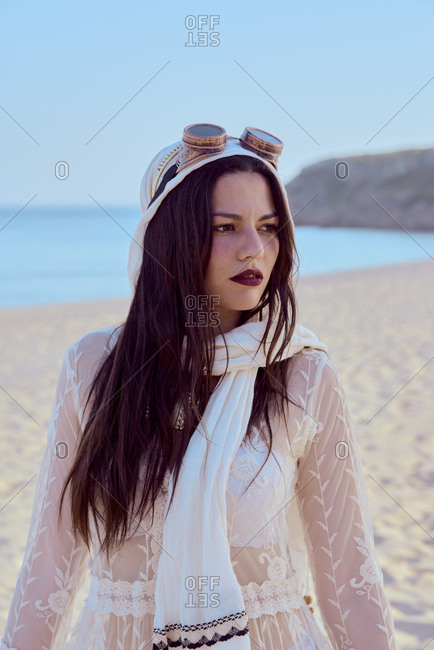 Portrait of an alternative model posing in the sand dunes by the sea