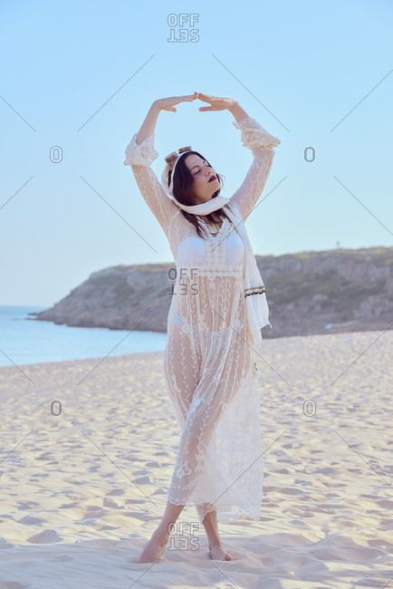 Alternative model poses on the sand dunes by the sea