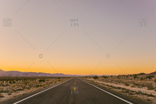 Isolated highway during sunset in desert of Baja, Mexico.