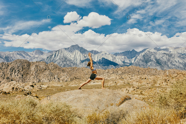 Young woman practicing yoga near Alabama Hills in northern California.