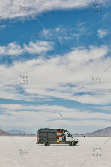 Camper van on Bonneville Salt Flats in Utah during a summer road trip.
