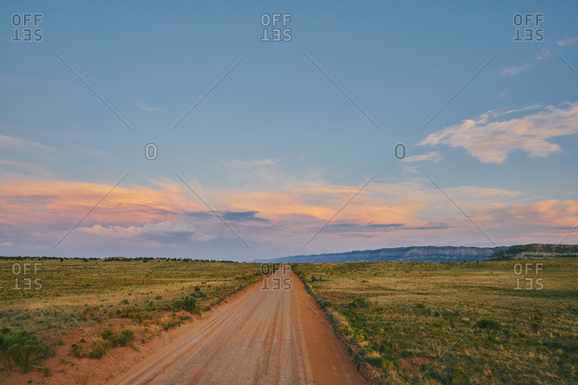 Open dirt road in Escalante, Utah during a summer road trip.