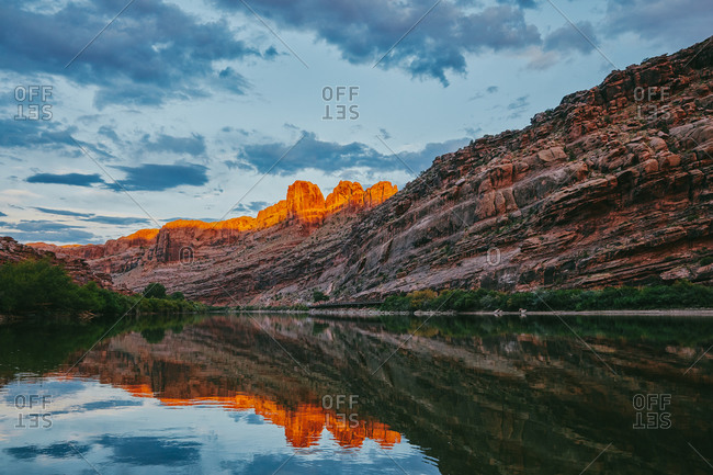 Sunset over mountain by Colorado River in Moab, Utah.