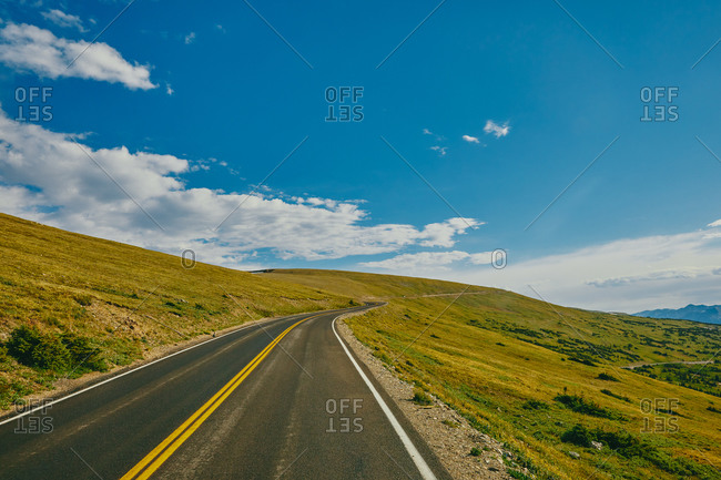 Open highway through Rocky Mountains National Park in Colorado.