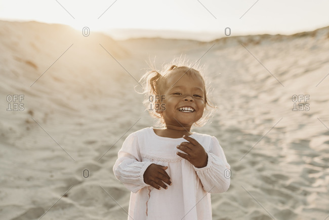 Portrait of adorable young girl at beach during sunset