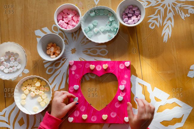 A Child Making a Picture Frame for Valentine's Day
