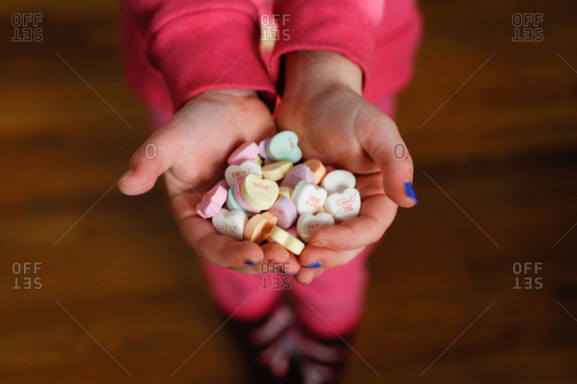 Child's Hands holding candy hearts on Valentine's Day