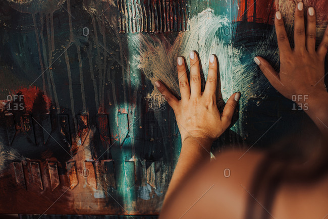 Hands of a painter on canvas