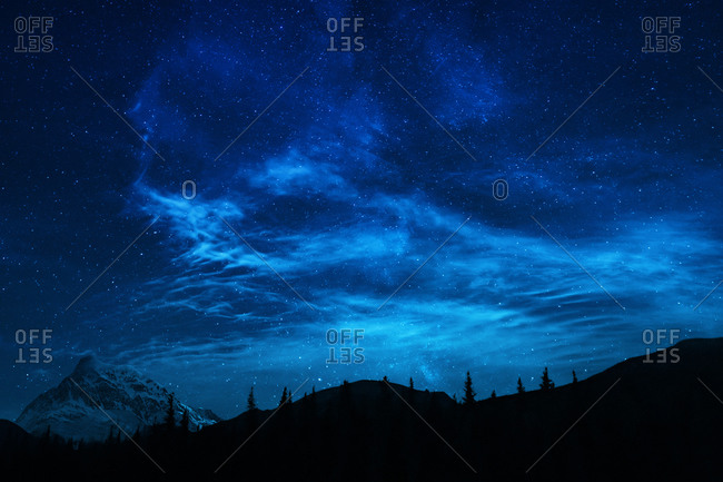 Blue Night Sky Stars And Milky Way In Mountain Scene