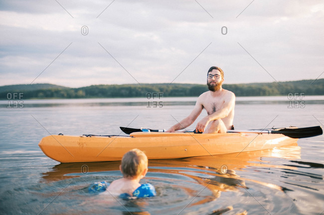 A father and son enjoying a hot summer day at the lake together
